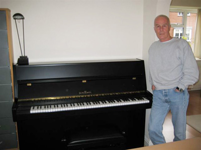 Allan at home with his Schimmel piano